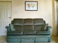 Green 3-seater sofa with two cushions
