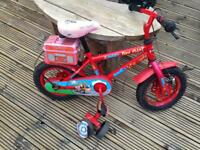 Toddlers first bike with stabalisers