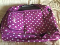 Lightweight purple polkadot suitcase
