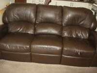 3 seater brown leather manual recliner settee.
