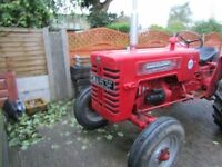 International B275 tractor with optional transport box. Very good condition. Registered 1967.