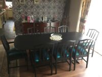 STAG MINSTREL TABLE AND 8 CHAIRS