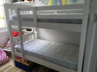 Children's white wooden bunk beds 3/4 length with space for storage. Good condition.