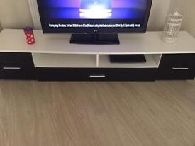 Black and white gloss tv unit