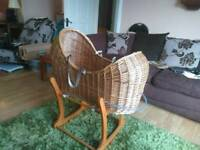 Wicker moses basket and base.