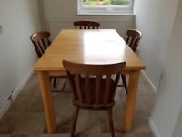 Solid light wood table and 4 chairs