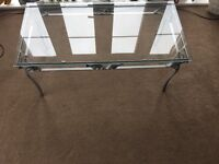 Glass coffee table , has a few scratches
