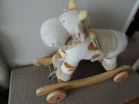 rocking cow and pull a long toy / horse with music