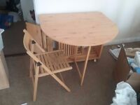 Fold up wooden table with 4 matching chairs, butterfly style