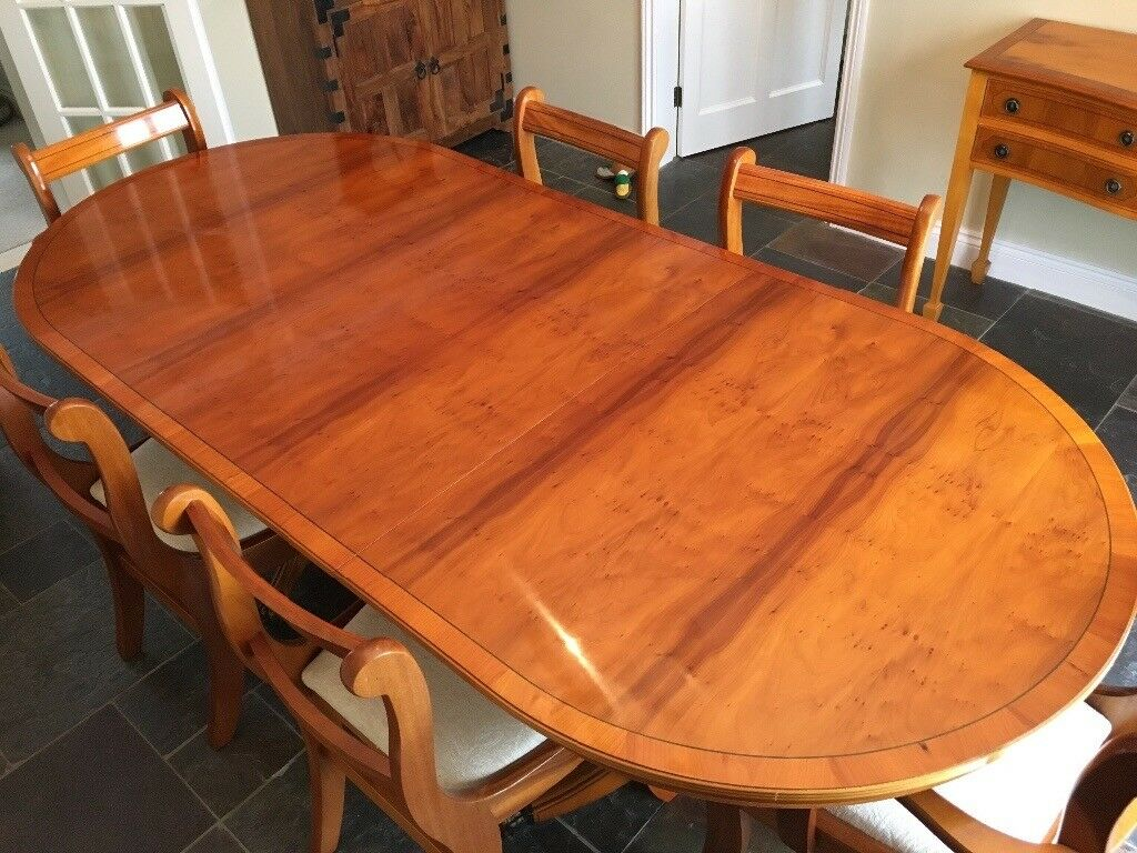 Oval Extending Yew Dining Table With Six Chairs