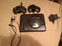 Original Sega Megadrive/Genesis with 2 Controllers and plenty of games to choose from