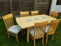 Solid table and 6 dining chairs
