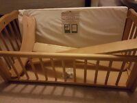 Swinging crib and matress with bedding