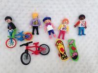 Children play mobile figures