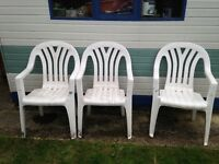 3 x White Plastic Stacking Garden Chairs for sale.