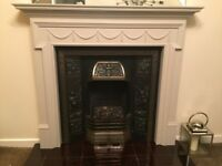 Cast iron fireplace,wooden surround, tiled hearth