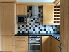 Kitchen -fitted Solid Light Oak unit with appliances