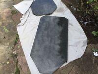 Two black granite offcuts