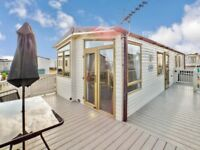 Superior Deluxe Caravan To Rent With Decking In Porthcawl, Trecco Bay, Park Dean. Sleeps 8