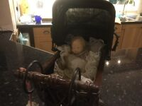 Small Victorian dolls pram with baby China doll
