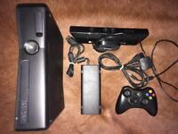 Xbox 360 slim console with Kinect and controller