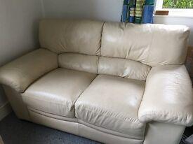 Two 2 seater Cream Leather Sofas