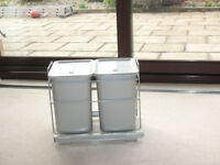 Twin waste bins which fit inside a kitchen cupboard and pull out when needed.