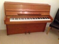 Danemann upright piano in east London