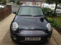 1.6 Mini Cooper hatchback 2009 chilli pack. black with Union Jack roof.