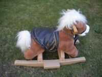 A PLUSH ROCKING HORSE VERY NICE