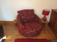 Large swivel armchair