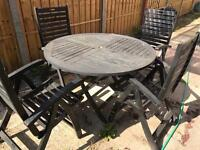 Lovely wooden table with four reclining chairs