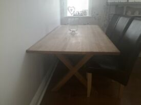 Marks and Spencer solid oak dining table and 6 lea6tger and oak chaird