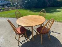 Ercol blonde 384 dining table and 365 Quaker chairs, blue label