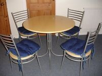 Modern circular table and four chairs