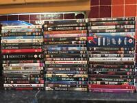 60 assorted DVDs.