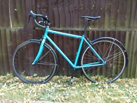Single speed road bike with mudguards