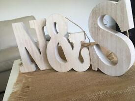Wooden decorative letters 'N' '&' 'S'