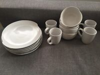 Set of dishes with cups