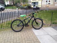 Bmx bike fully black with a hint of orange