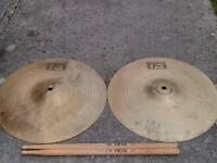 Cymbals and a pair of drumsticks