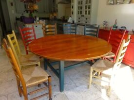 Chalon circular dining table with 8 Ladder Back chairs