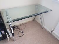 Steel stands and tempered glass top desk.