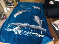 Large throw with dolphins on.