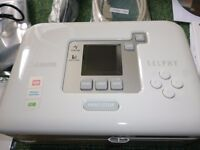 CANON SELPHY CP720 PHOTO PRINTER HARDLY USED WITH 2 SPARE INK CARTRIDGES AND LOTS OF PHOTO PAPER