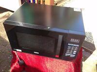 delonghi microwave. brand new. black