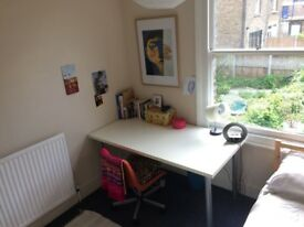 Large white desk and office chair