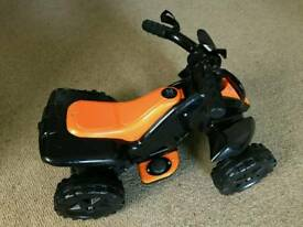 Kids 6 v ride on quad with charger