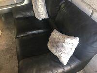 Gorgeous deep cushioned italian leather black sofa