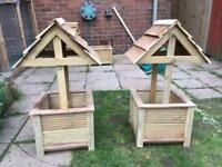 Pair of wooden wishing well garden planters with free local delivery